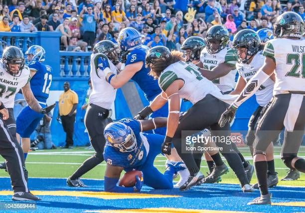 San Jose State Spartans defensive tackle Boogie Roberts breaks through past Hawaii Warriors linebacker Jahlani Tavai for a touchdown play during the...
