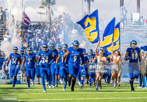 San Jose State Spartans defensive tackle Bryson Bridges leads the San Jose State Spartans team onto the field for the game between the Hawaii...