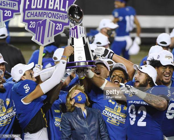 San Jose State Spartans Director of Athletics Marie Tuite looks up as players, including quarterback Nick Starkel and defensive lineman Cade Hall,...