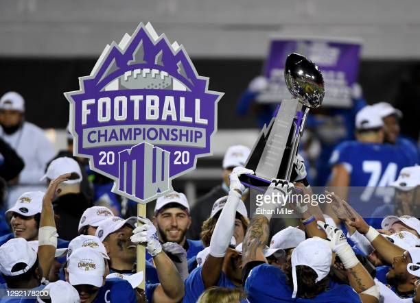 San Jose State Spartans players celebrate with the championship trophy after defeating the Boise State Broncos 34-20 to win the Mountain West...