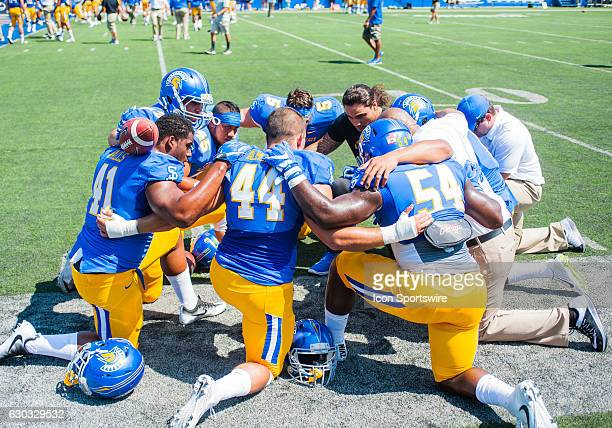San Jose State Spartans players pray before the regular season game between the San Jose State Spartans verses the Portland State Vikings at Spartan...