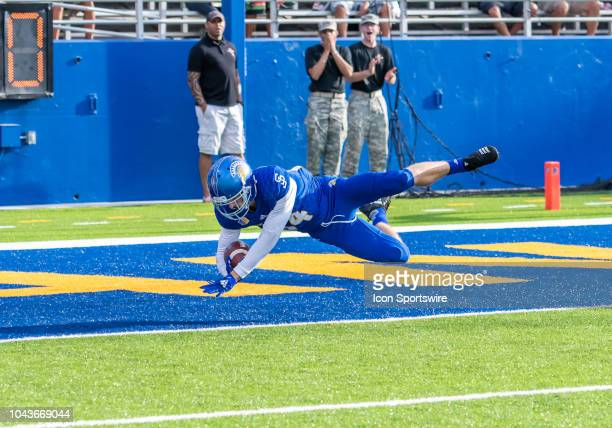 San Jose State Spartans wide receiver Bailey Gaither flies into the end zone for a touchdown on a pass play during the game between the Hawaii...