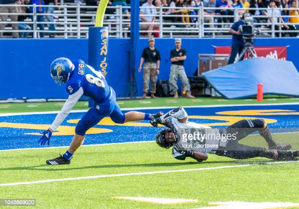 San Jose State Spartans wide receiver Bailey Gaither struggles to maintain his balance while Hawaii Warriors defensive back Zach Wilson hits the...