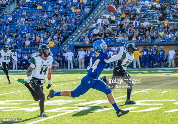 San Jose State Spartans wide receiver Bailey Gaither targets a pass threaded through Hawaii Warriors defensive back Manu HudsonRasmussen and Hawaii...