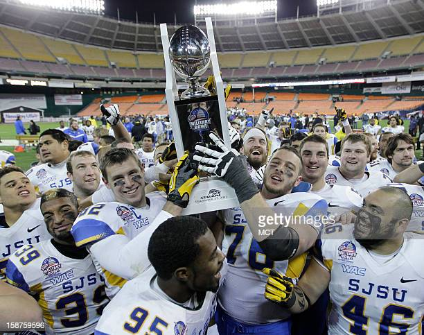 San Jose State tight end Ryan Otten, left, and offensive tackle David Quessenberry hold the Military Bowl trophy after their game against Bowling...
