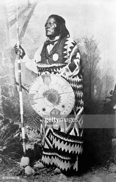 San Juan a Mescalero Apache chief standing fulllength holding a spear and shield | Location photography studio
