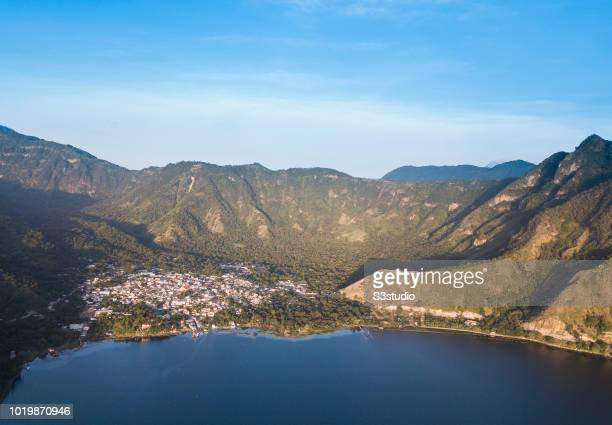 San Juan la Laguna is seen under the light of sunrise at the shores of Lake Atitlan on 12 August 2018 in the Solola department Guatemala Central...
