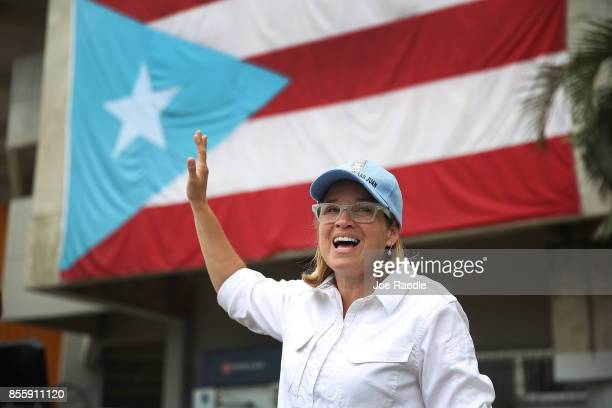 San Juan Mayor Carmen Yulin Cruz speaks to the media as she arrives at the temporary government center setup at the Roberto Clemente stadium in the...