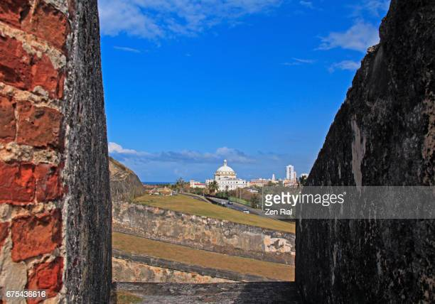 san juan, puerto rico cityscape and fort san cristobal (castillo san cristobal) - old san juan wall stock photos and pictures