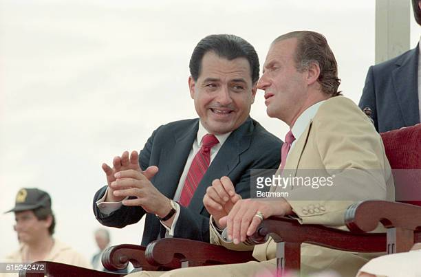 5/25/1987 San Juan Puerto Rico Puerto Rican Governoer Rafeal Hernandez Colon shares a word with Spain's king Juan Carlos during festivities in honor...