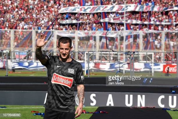 San Lorenzo's legend Leandro Romagnoli waves to fans during his farewell match at Pedro Bidegain Stadium on December 15 2018 in Buenos Aires Argentina