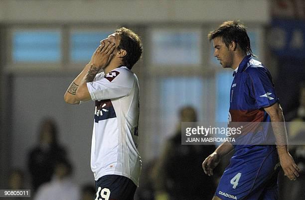 San Lorenzo's midfielder Alejandro Gomez gestures next to Tigre's defender Jose San Roman during a Copa Sudamericana football match between two...