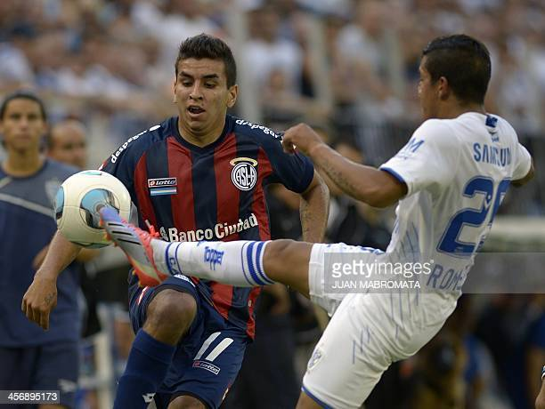 San Lorenzo's midfielder Angel Correa vies for the ball with Velez Sarsfield's midfielder Lucas Romero during their Argentina's first division...