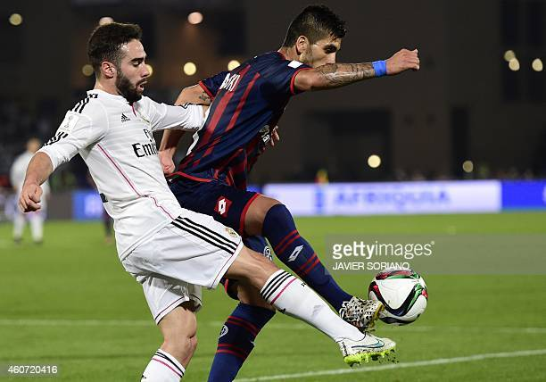 San Lorenzo's midfielder Enzo Kalinski vies for the ball with Real Madrid's defender Dani Carvajal during their FIFA Club World Cup final football...