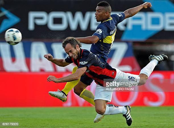 San Lorenzo's midfielder Fernando Belluschi vies for the ball with Boca Juniors' defender Frank Fabra during their Argentina First Division football...