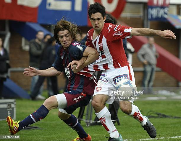 San Lorenzo's midfielder Julio Buffarini and Instituto's midfielder Franco Canever vie for the ball during the Argentina's Promotion football match...
