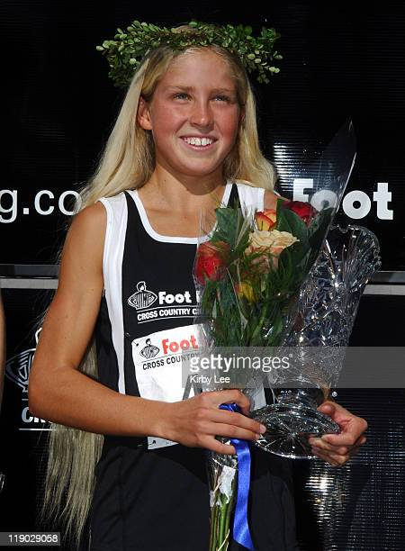 San Luis Obispo Mission Prep freshman Jordan Hasay poses with the winner's trophy after winning the girls race in 1705 in the Foot Locker National...