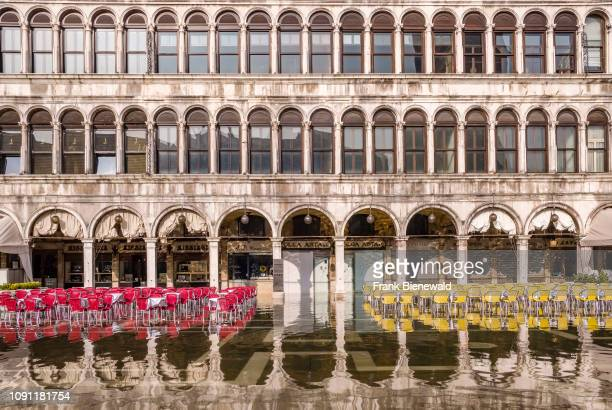 San Marco Square Piazza San Marco with empty tables and chairs of a restaurant flooded during the Acqua alta