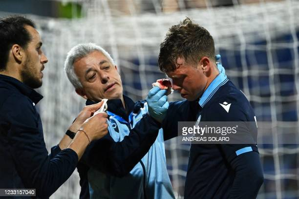 San Marino's forward Nicola Nanni receives medical attention during a friendly football match between Italy and San Marino at the Sardegna Arena in...