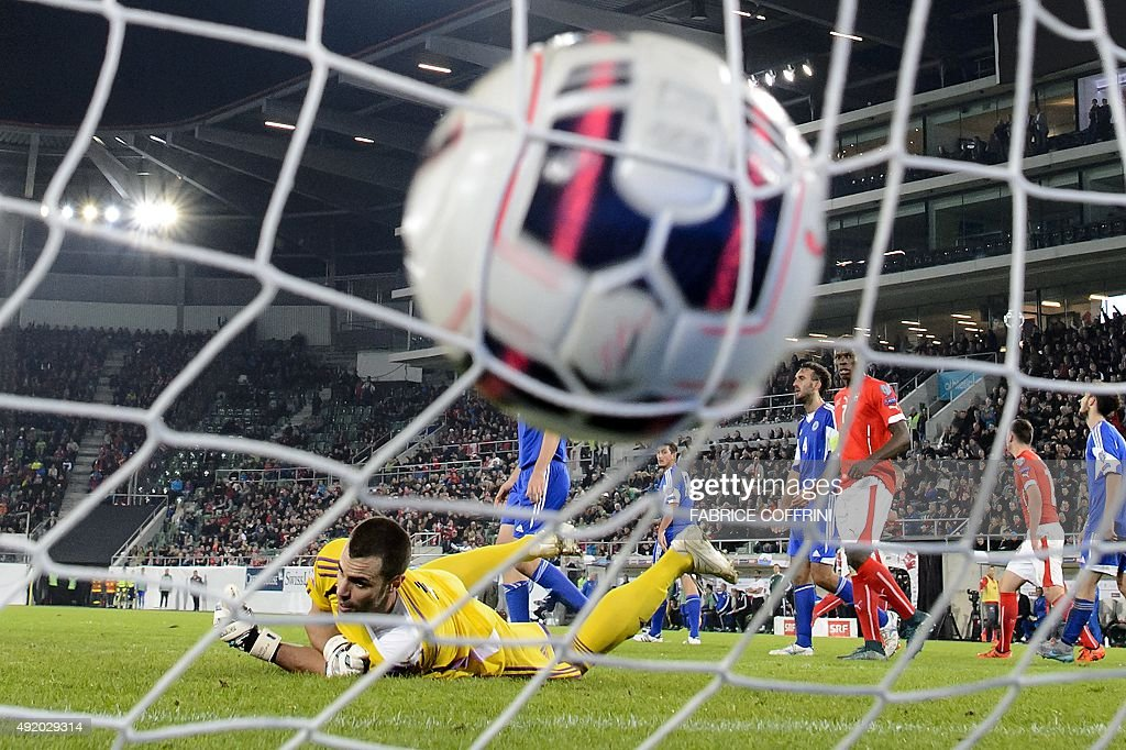 San Marino's goalkeeper Aldo Simoncini (L) receives a goal during the Euro 2016 qualifying group E football match between Switzerland and San Marino on October 9, 2015 at the AFG Arena in St Gallen.