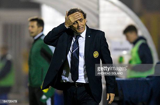 San Marino's Head coach Giampaolo Mazza reacts during the FIFA World Cup 2014 qualifying football match San Marino vs Ukraine on October 15 2013 at...