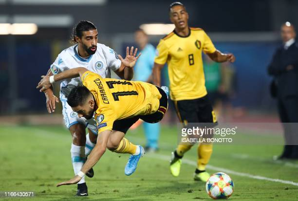 San Marino's midfielder Manuel Battistini tackles Belgium's midfielder Yannick FerreiraCarrasco during the Euro 2020 qualifier football match San...