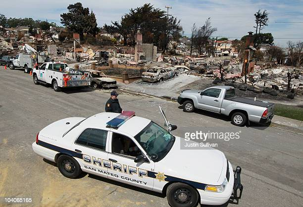 San Mateo County Sheriff deputy stands guard on a street devastated by fire following a deadly gas main explosion on September 13 2010 in San Bruno...