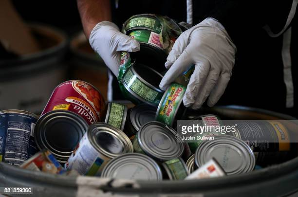 San Mateo High School student sorts donated canned foods at San Mateo High School on November 29 2017 in San Mateo California San Mateo High School...