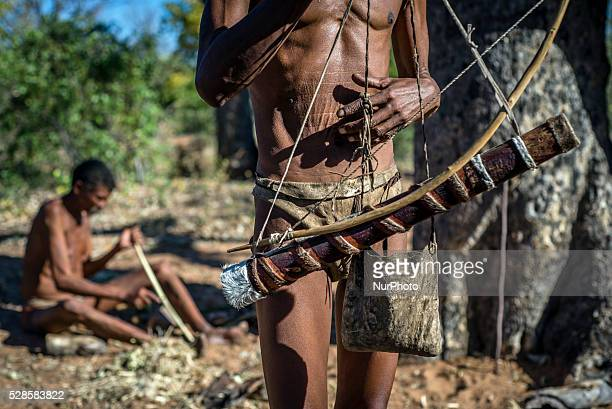 San men preparing for hunting in the Living Museum of the JuHoansiSan Grashoek Namibia