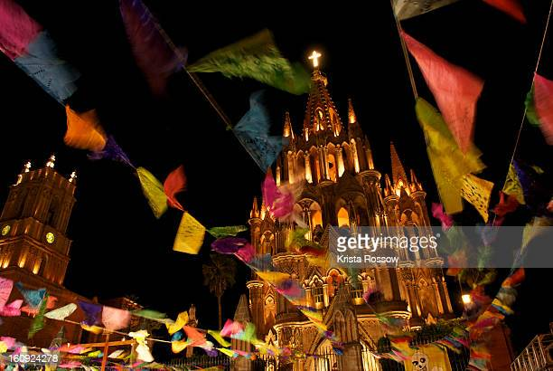view of la parroquia church in san miguel de allende. - day of the dead festival stock photos and pictures
