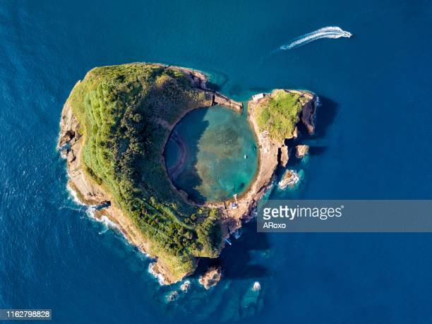 san miguel island, azores, portugal. top view of islet of vila franca do campo.  azores aerial panoramic view. crater of an old underwater volcano. bird eye view. - insel stock-fotos und bilder