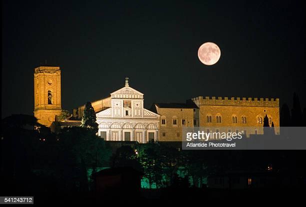 san miniato al monte basilica under full moon - san miniato stock pictures, royalty-free photos & images