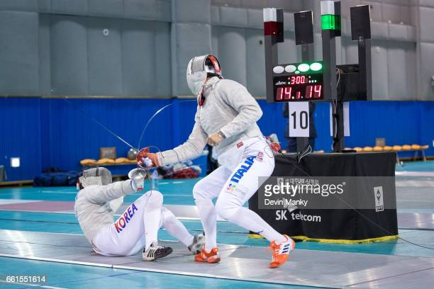 San Nam of Korea lfalls to the ground as Aldo Montano of Italy makes a match winning point during the preliminary rounds of the SK Telecom Seoul...