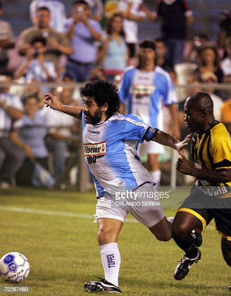 Diego Armando Maradona of Argentina fights for the ball with Milton Tyson Nunez during a football match at the Olympic stadium in San Pedro Sula 25...