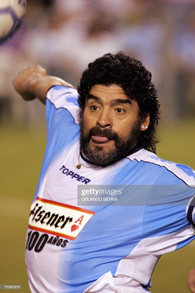 Diego Armando Maradona plays with a football at the ...