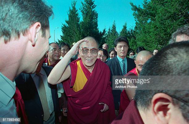The Dalai Lama shields his eyes from the sun as he arrives on top of Mount Tamalpais near San Francisco to perform a traditional Tibetan peace...