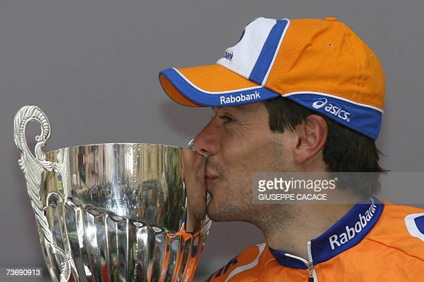 Spain's Oscar Freire kisses the trophy on the podium of the MilanSan Remo cycling race the opening oneday classic of the season 24 March 2007 in San...