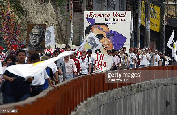 People take part in a rally to commemorate the 26th anniversary of the murder of Roman Catholic Archbishop Oscar Arnulfo Romero 24 March 2006 in San...