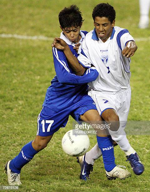 Salvadorean Gilberto Baires and Honduran Ronald Martinez fight for the ball during a friendly U17 match of national soccer teams at the Cuscatlan...