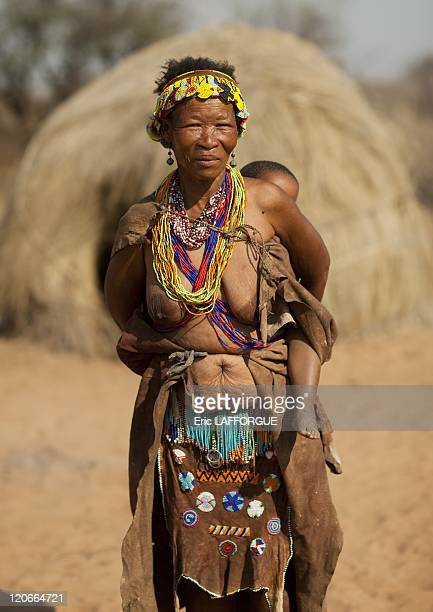 San Woman Carrying Her Baby On Her Back in Namibia on August 22 2010 San are an ethnic group of South West Africa They live in the Kalahari Desert...