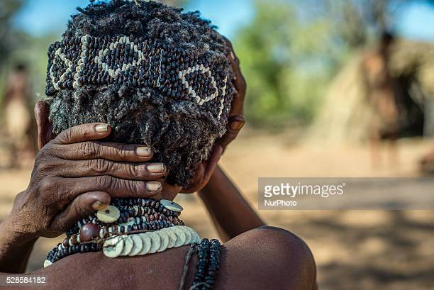 San woman in a traditional handmade jewelry It is made of plant seeds and ostrich eggshells Living Museum of the JuHoansiSan Grashoek Namibia