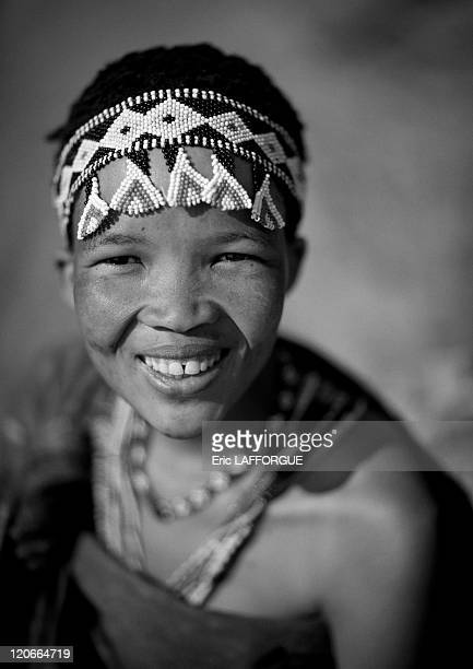 San Woman Smiling in Namibia on August 22 2010 San are an ethnic group of South West Africa They live in the Kalahari Desert across the borders of...