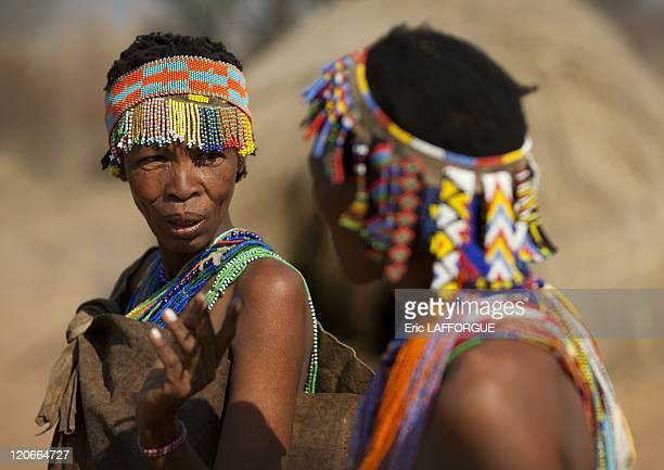 San Women With Beaded Headdresses in Namibia on August 22 2010 San are an ethnic group of South West Africa They live in the Kalahari Desert across...