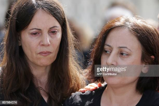Sana and Najat sisters of late Syrian actress and activist Fadwa Suleimane attend her funeral in Montreuil east of Paris on August 23 2017 The Syrian...