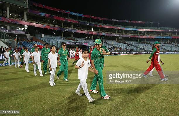 Sana Mir Captain of Pakistan and Jahanara Alam Captain of Bangladesh lead their teams out during the Women's ICC World Twenty20 India 2016 match...