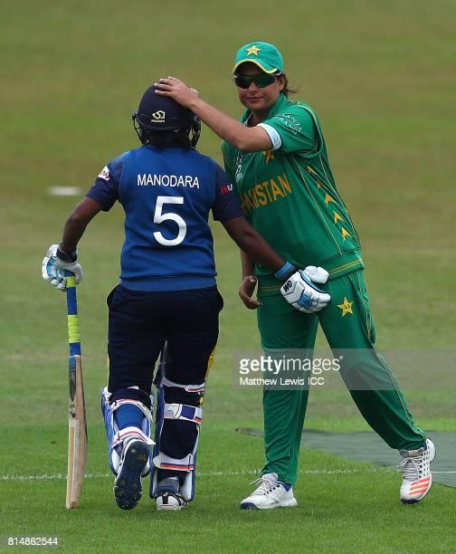 Sana Mir captain of Pakistan consoles Dilani Manodara of Sri Lanka after she was caught by Sidra Nawaz of Pakistan off the bowling of Diana Baig...