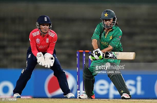 Sana Mir Captain of Pakistan plays a reverse sweep shot as Sarah Taylor of England looks on during the Women's ICC World Twenty20 India 2016 match...