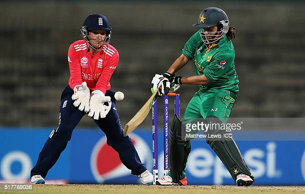 Sana Mir Captain of Pakistan plays a reverse sweep shot as Sarah Taylor of England looks on during the Women's ICC World Twenty20 India 2016 match...