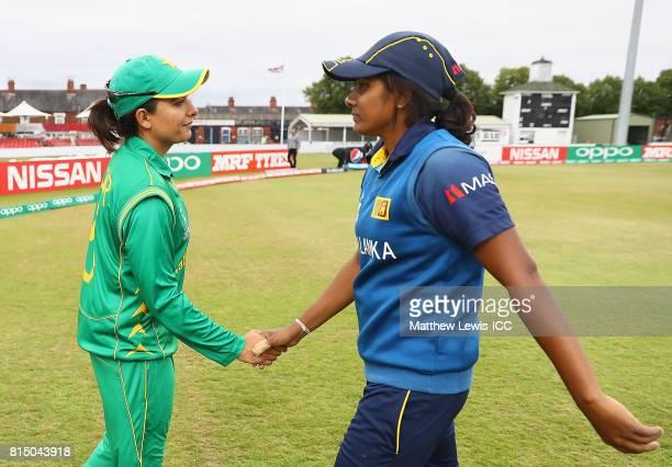 Sana Mir captain of Pakistan shakes Inoka Ranaweera captain of Sri Lanka after her teams loss during the ICC Women's World Cup 2017 match between...