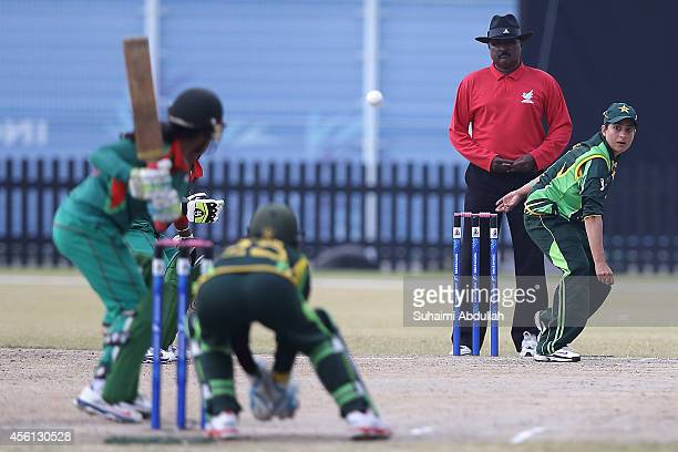 Sana Mir of Pakistan bowls during the cricket womenÕs final match between Pakistan and Bangladesh on day seven of the 2014 Asian Games match at...